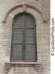 Window with wooden shutters - A window with wooden shutters ...