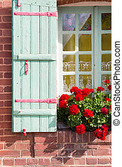 Window with wooden shutters