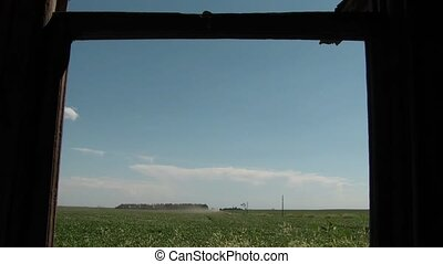 Window Without Glass - Farm Field - Clip of hands opening up...