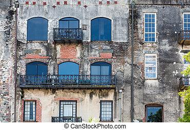 Windows and Black Iron on Old Brick Wall