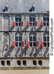 Windows and red shutters on the historic town hall of Gouda