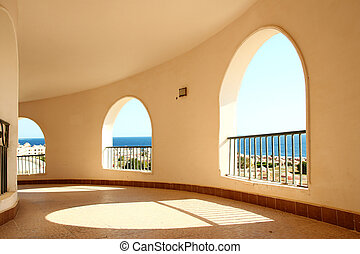Windows arch with sea view