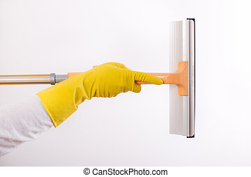 Windows cleaning squeegee - Woman with rubber gloves holding...