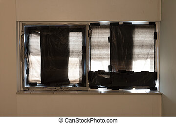 Windows coverd with black plastic bags