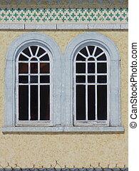 windows detail - Two round top paned windows