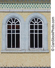 windows detail - Two round top paned windows
