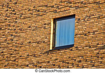 Windows in brick wall