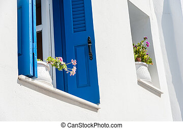 Windows in Naxos - Blue windows with flowers in Naxos,...