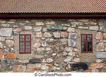 Windows in stone wall
