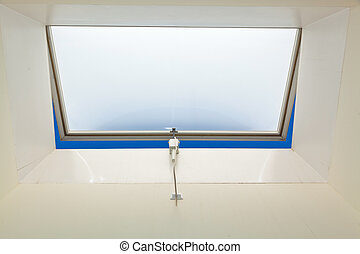 windows in the roof - a roof window in an apartment for...