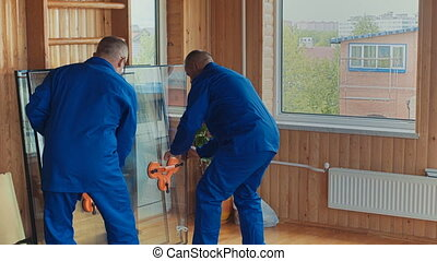 windows installation workers. replacement glass