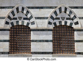 Windows of a building in the Piazza del Duomo of Siena, Italy