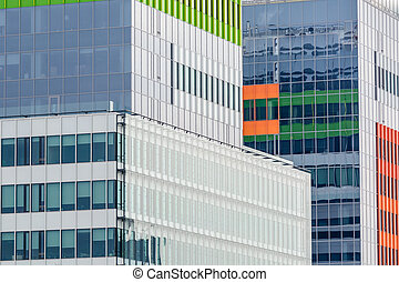 Windows of a modern business building exterior. Horizontal image of abstract modern building background for design with colorful windows.
