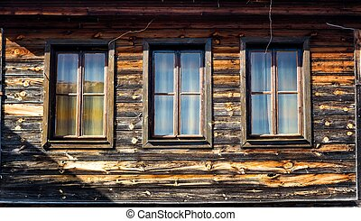 Windows of a wooden cottage