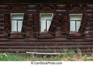 Windows of an old wooden hut in the village
