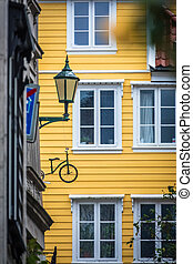 Windows of an old yellow house in Bergen