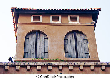 windows of Italian style building at Palio Khao Yai