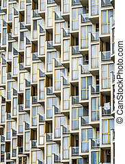 Windows of the multistorey building in the day - Facade of a...
