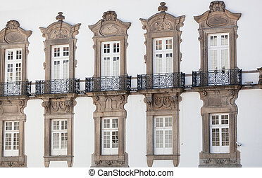 Windows on a white wall of the house close up