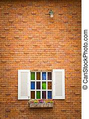 Windows on brick wall