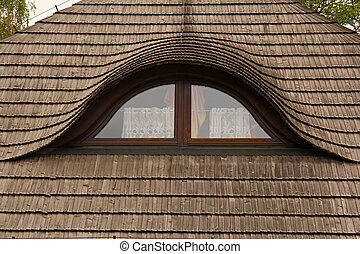 windows on old wooden roof