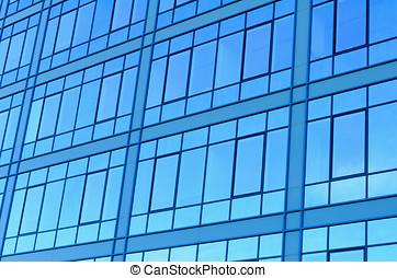 Windows reflecting blue sky