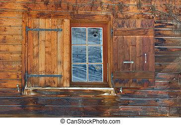 windows shutters - open window shutters on a wooden cottage