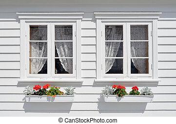 Windows with flowers - Norwegian house