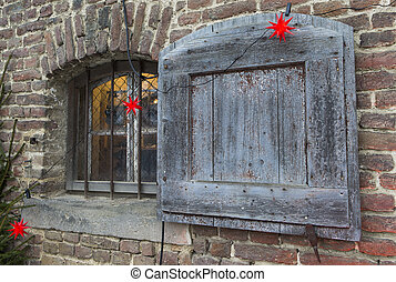 Windows with shutter - The photo shows a Christmas decorated...