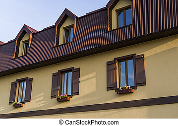 windows with shutters and pots for flowers