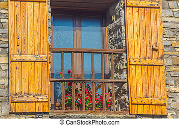Windows with stone house wood shutter