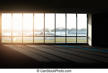 Windows with sunset at Airport.