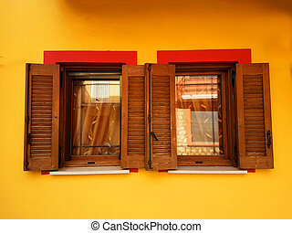 windows yellow red isolated two wooden  vivid colors brigth in ioannina greece