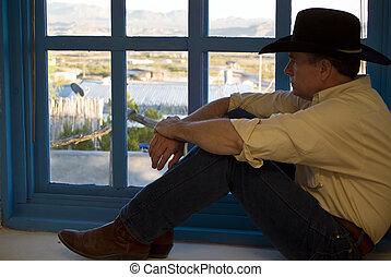 Windowsill Perch - A man dressed in western attire, sitting...