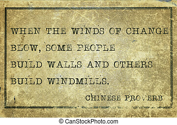 When the winds of change blow - ancient Chinese proverb printed on grunge vintage cardboard