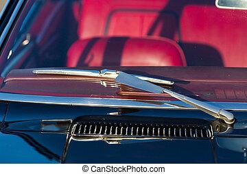 Windscreen and wiper blade of classic Amercian sports car.