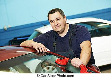 Windscreen repair - Automobile glazier repairman at...