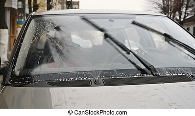 Windscreen windshield wipers in motion with cleaning wash...
