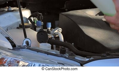 Windscreen wiper fluid - Refilling windscreen wiper fluid in...