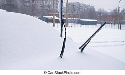 windscreen wipers at winter - windscreen wipers on a car at...