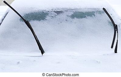 Windscreen Wipers on Snowy Car in winter time.