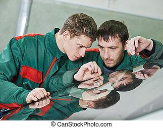Windshield repair workers - Automobile glazier repairman...