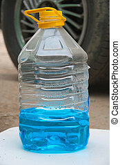 Plastic blank container filled with blue liquid