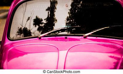 windshield wiper arm on pink vehicle