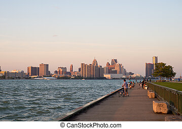 WINDSOR, ONTARIO - SEPT 2, 2017: Panoramic view of Windsor's waterfront with downtown Detroit skyline and the General Motors Renaissance Center in the background.