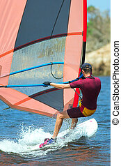 Windsurfer #17 - Fast moving windsurfer on the water at...