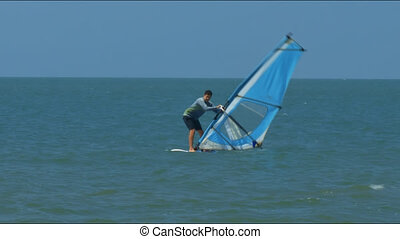 Windsurfer Beginner Holds Sail Stands on Surfboard -...