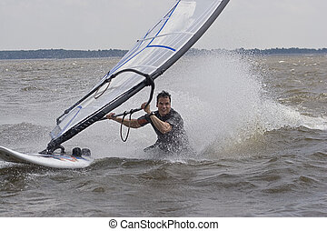Windsurfer body drag - Windsurfer doing a body drag trick in...