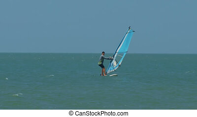 Windsurfer Happy to Stand on Surfboard against Wind -...