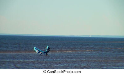 windsurfer is on the Bay